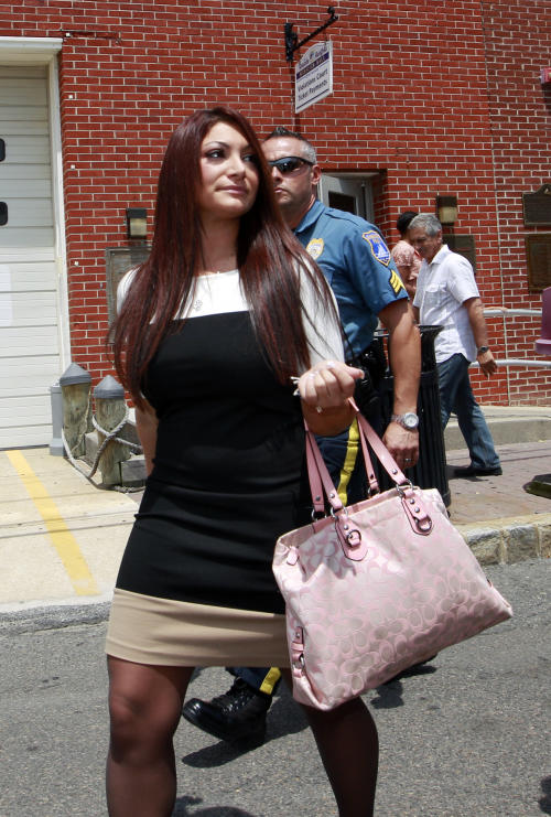 """Jersey Shore"" cast member Deena Cortese walks from court after a hearing Tuesday, July, 3, 2012, in Seaside Heights, N.J. The Cortese was in Seaside Heights municipal court on a change of interfering with traffic for an incident in which police say she was dancing in a street and blocking the flow of traffic. She pleaded guilty to failing to use the sidewalk and paid a $106 fine. (AP Photo/Mel Evans)"
