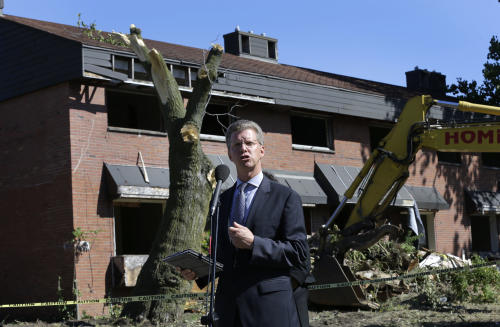 Shaun Donovan, United States Department of Housing and Urban Development Secretary, speaks during the first stage of demolishing the Frederick Douglass Homes in Detroit, Wednesday, Sept. 4, 2013. The graffiti-covered complex comprising several city blocks is better known as the Brewster projects. A $6.5 million emergency federal grant covers the initial phase of demolition and cleanup, and officials say the city will be eligible for more money when that's completed. The federal money comes at a crucial time for the city, which is overseen by a state-appointed emergency manager and in July became the nation's largest city to file for bankruptcy. (AP Photo/Paul Sancya)