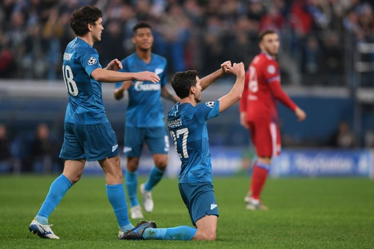 Zenit Saint Petersburg's Russia midfielder Magomed Ozdoev scored a late second to make sure of all three points against Lyon