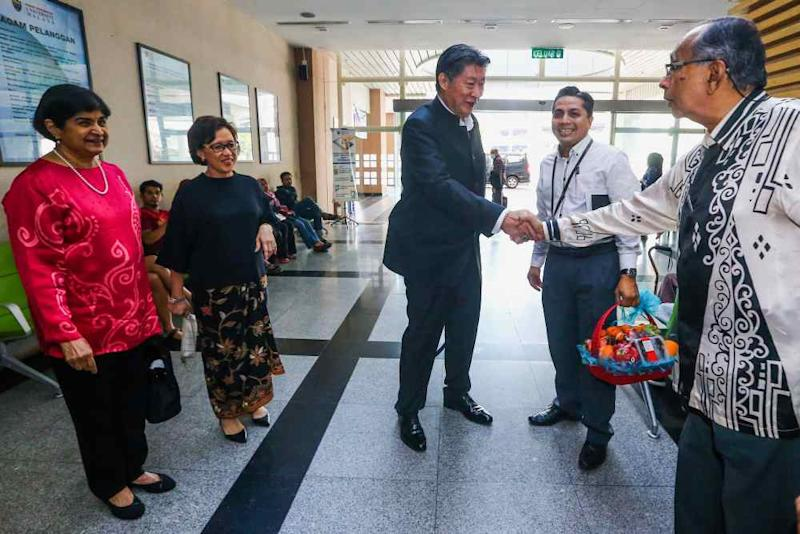 The Malay Mail Care Fund trustees meet up at University Malaya Specialist Centre before presenting eight-year-old Adam Miqail with the special gift, May 24, 2019.