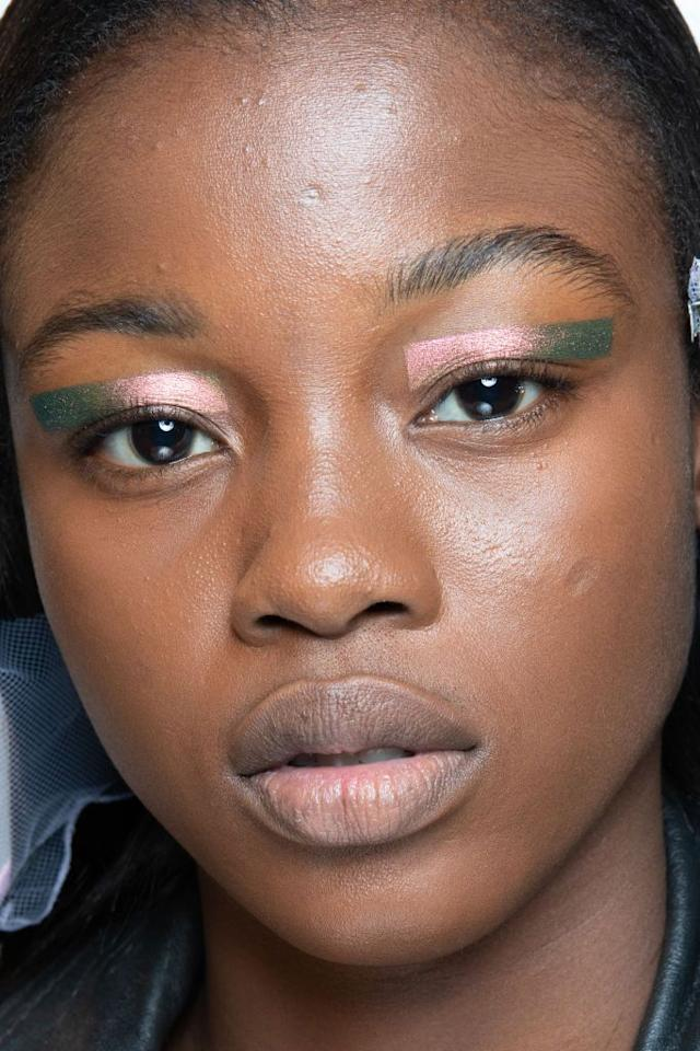 <p>Consider wearing liner and shadow outside the bounds of your lash lines. At Prada, floating rectangles of iridescent shadow gave every model a striking, futuristic vibe.</p>