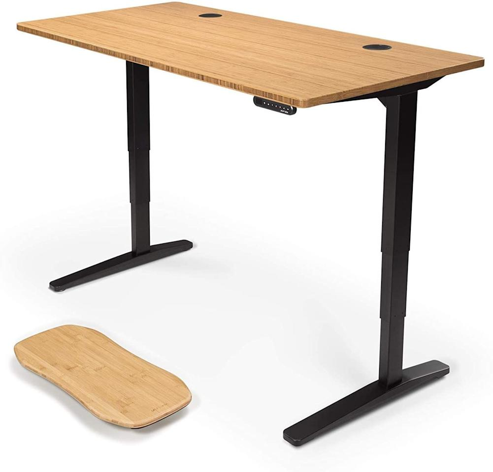 "<p><strong>UPLIFT Desk</strong></p><p>upliftdesk.com</p><p><strong>$599.00</strong></p><p><a href=""https://www.upliftdesk.com/uplift-v2-standing-desk-v2-or-v2-commercial/"" target=""_blank"">Shop Now</a></p><p>Our best tested, Uplift's standing desk is very stable when adjusted via electronic keypads and can accommodate a wide range of user heights. Rothman notes that this may be the best fit for a couple or for shared office spaces due to its versatility in adjustment ranges. While a bamboo-finished desk is standard here, Uplift offers 19 different finishes on its website, and four different frames, plus a few add-ons you can select if need be. The desk itself won't move even if you're a heavy typer or are constantly switching modes during the day, as there's a steel crossbar between the desk's legs to reduce any sway.<br></p>"
