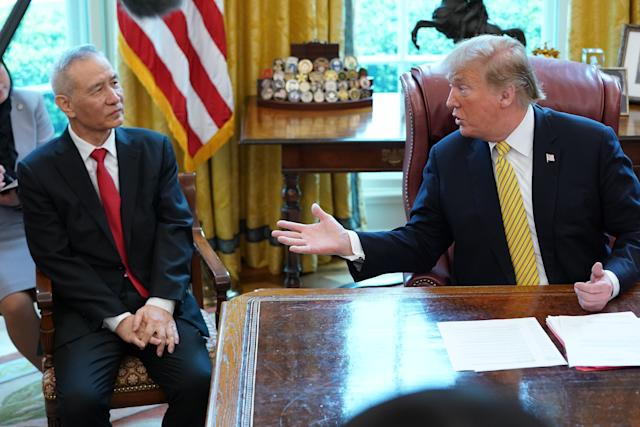 WASHINGTON, DC - APRIL 04: U.S. President Donald Trump (R) and Chinese Vice Premier Liu He talk to reporters in the Oval Office at the White House April 04, 2019 in Washington, DC. The New York Times reported Thursday that Trump is likely to announce plans for a future summit meeting with Chinese President Xi Jinping to resolve remaining trade issues and sign a final agreement between the U.S. and China. (Photo by Chip Somodevilla/Getty Images)