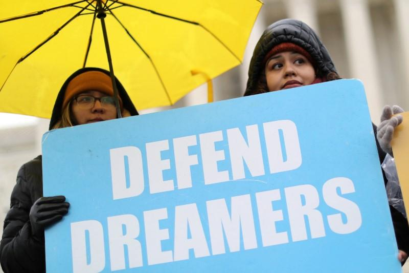 FILE PHOTO: People gather outside the U.S. Supreme Court during oral arguments in Trump administration's bid to end the DACA program in Washington