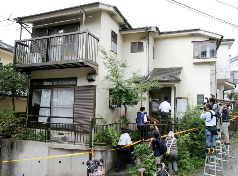 Police searching the home of murder suspect Satoshi Uematsu after his arrest in 2016
