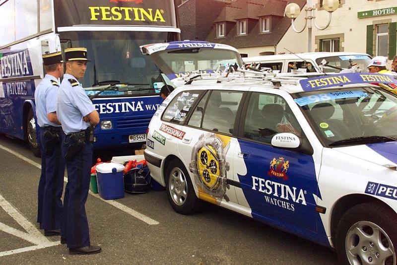 Policemen surround the Festina camp