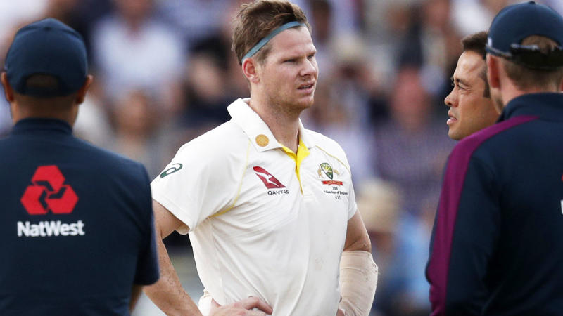 Steve Smith, pictured here after he was struck on the neck. (Photo by ADRIAN DENNIS/AFP/Getty Images)