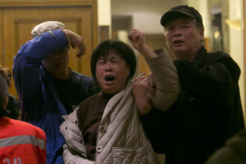 """A relative of one of the Chinese passengers aboard the Malaysia Airlines, MH370 grieves after being told of the latest news in Beijing, China, Monday, March 24, 2014. A new analysis of satellite data indicates the missing Malaysia Airlines plane crashed into a remote corner of the Indian Ocean, Malaysian Prime Minister Najib Razak said Monday. Malaysia Airlines said in a statement to the families that """"our prayers go out to all the loved ones of the 226 passengers and of our 13 friends and colleagues at this enormously painful time."""" (AP Photo/Ng Han Guan)"""