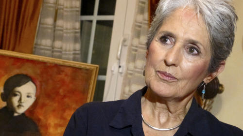 In this April 5, 2013 photo, Joan Baez speaks to a reporter in her hotel room in Hanoi, Vietnam. The folk singer and social activist visited Vietnam recently for the first time since she came to the country in December 1972 as part of an American peace delegation. Baez painted the picture of the young boy during her recent stay in Hanoi. (AP Photo/Dinh Hau)
