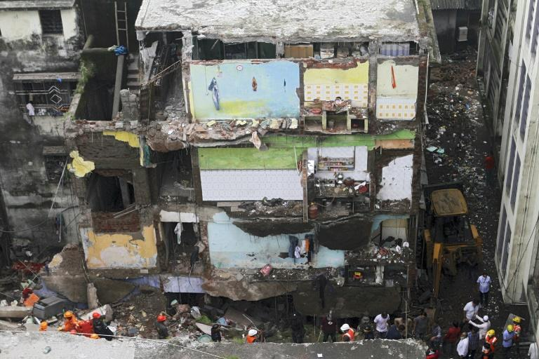 At least 15 dead, 25 feared trapped in India building collapse