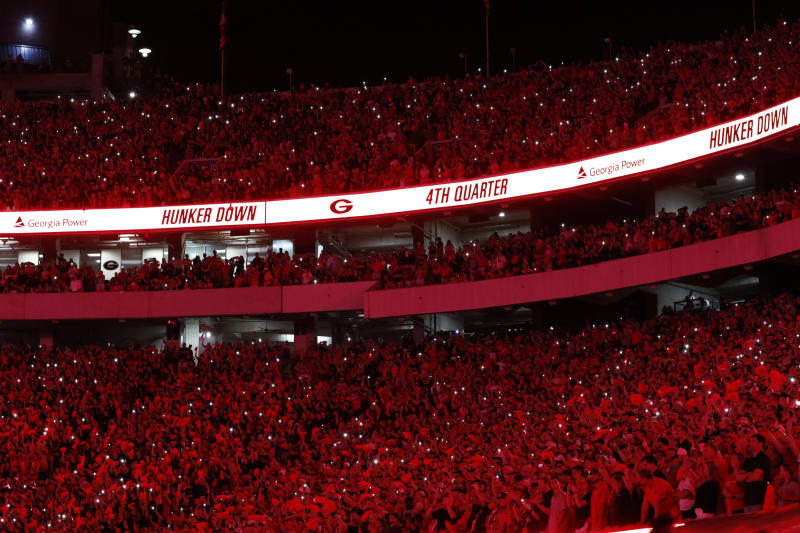 Georgia turns Sanford Stadium red at the beginning of the fourth quarter against Notre Dame in an NCAA college football game Saturday, Sept. 21, 2019, in Athens, Ga. (AP)