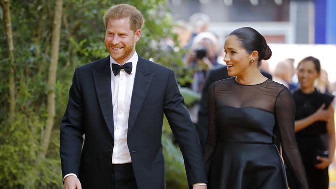 Pangeran Harry dan Meghan Markle hadiri premier film The Lion King di London, Inggris, 14 Juli 2019. (TOLGA AKMEN / AFP)