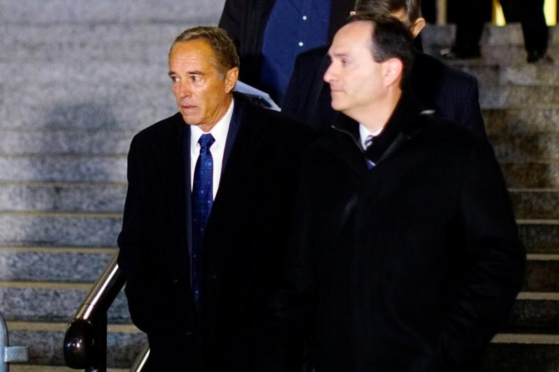 Chris Collins, former U.S. Representative for New York's 27th congressional district, exits the New York Federal Court after his sentencing,