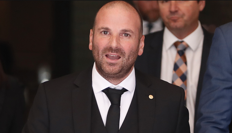 George Calombaris in a black suit