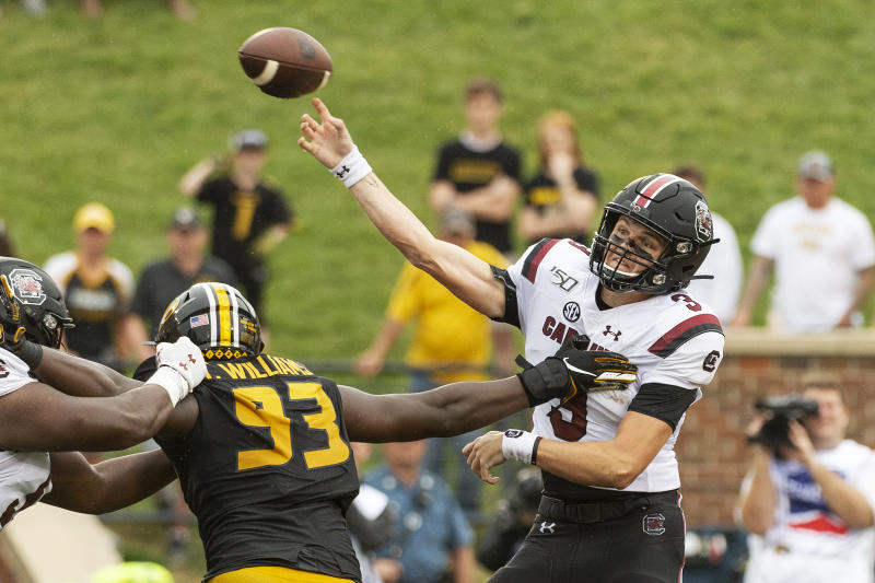 South Carolina quarterback Ryan Hilinski, right, is hit as he throws by Missouri's Tre Williams, left, during the second quarter of an NCAA college football game, Saturday, Sept. 21, 2019, in Columbia, Mo. (AP Photo/L.G. Patterson)