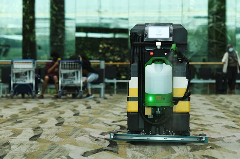 SINGAPORE, July 1, 2020 -- An automatic cleaning robot equipped with disinfectant spray attachment works in Singapore's Changi Airport on July 1, 2020. (Photo by Then Chih Wey/Xinhua via Getty) (Xinhua/ via Getty Images)