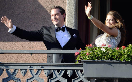 "Christopher O'Neill, from the US, left, and Swedish Princess Madeleine, right, wave from the balcony of the Grand Hotel in Stockholm, Sweden, Friday June 7, 2013, prior to a dinner for the couple at the hotel, the day before their wedding. Three years ago she crossed the Atlantic with a broken heart. Now Sweden's ""party princess"" returns from New York to Stockholm to tie the knot with her new, British-American love. On Saturday, Princess Madeleine — the Duchess of Halsingland and Gastrikland — will wed New York banker Christopher O'Neill in the Swedish capital, bringing together European royals and top New York socialites for a grand celebration. (AP Photo/Scanpix Sweden/Bertil Enevag Ericson) SWEDEN OUT"