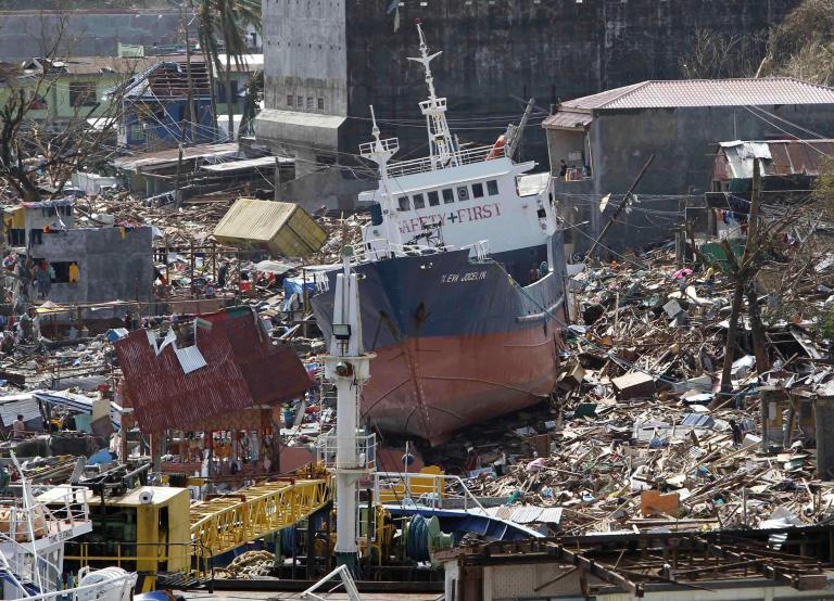 A cargo ship washed ashore is seen after super typhoon Haiyan hit Anibong town, Tacloban