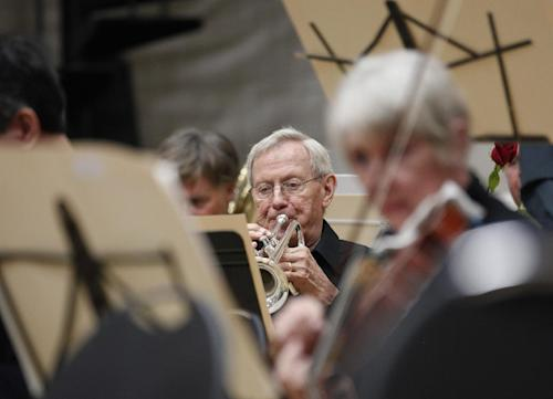 In this photo taken Monday, Sept. 24, 2012, Ron Hasselman, a retired trumpet player of the Musicians of the Minnesota Orchestra performs during the ACME Concert, a free event at the North Community YMCA, in Minneapolis. The Minnesota Orchestra was called the world's greatest not long ago, welcome recognition for musicians outside a top cultural center. Now its members are locked out of Orchestra Hall, stuck in the same kind of labor-management battle recently afflicting teachers and football referees. (AP Photo/Stacy Bengs)