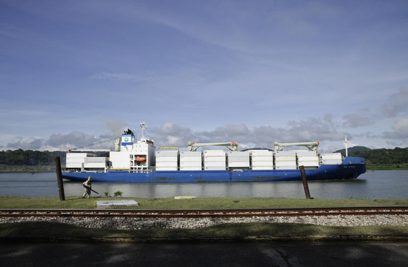 A cargo ship navigates the Panama Canal waters in Gamboa, Panama, Wednesday, June 17, 2020. The Panama Canal began to feel the first adverse effects of the coronavirus pandemic on its business after registering a drop in its ship transits while applying rigorous measures to prevent further contagion among its workers. (AP Photo/Arnulfo Franco)