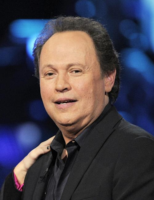 "FILE - In this April 6, 2008 file photo, Billy Crystal is shown at the ""Idol Gives Back"" fundraising special of ""American Idol"" in Los Angeles. Actor Billy Crystal has helped raise $1 million to rebuild a beach town on New York's Long Island hard-hit by Superstorm Sandy, Saturday, June 22, 2013.(AP Photo/Mark J. Terrill, file)"