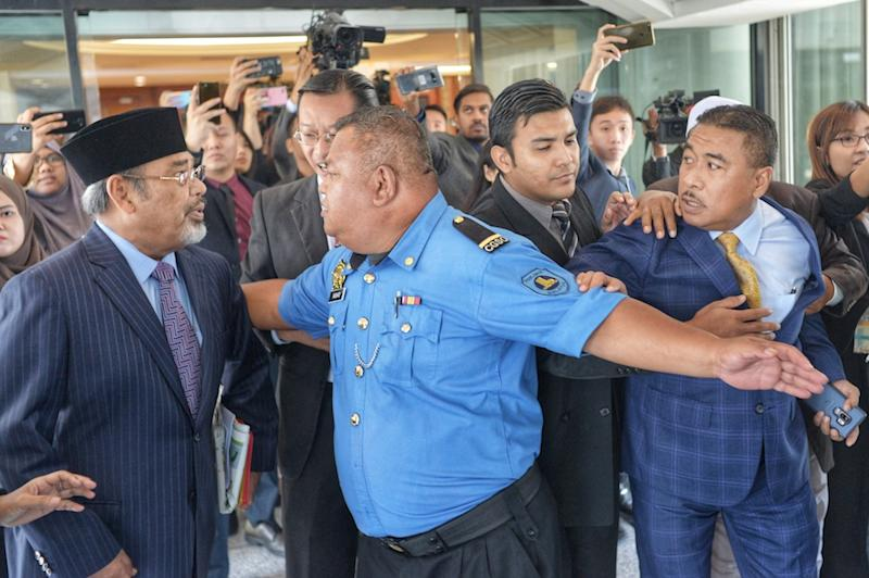 Pasir Salak MP Datuk Seri Tajuddin Abdul Rahman and Kuala Krau MP Datuk Seri Ismail Mohamed Said almost come to blows in Parliament November 20, 2019. — Picture by Shafwan Zaidon