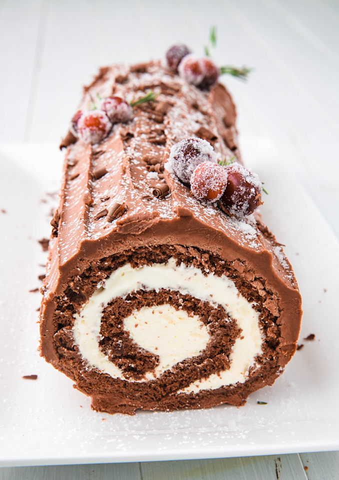 """<p>The cake represents the yule log that families would burn starting on Christmas Eve. </p><p>Get the recipe from <a href=""""https://www.delish.com/cooking/recipe-ideas/a24276998/buche-de-noel-yule-log-cake-recipe/"""" target=""""_blank"""">Delish</a>.  </p>"""