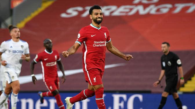 Striker Liverpool, Mohamed Salah mencetak hattrick saat timnya meladeni Leeds United. Liverpool menang 4-3 di Anfield, Sabtu (12/9/2020) WIB (Shaun Botterill / POOL / AFP)