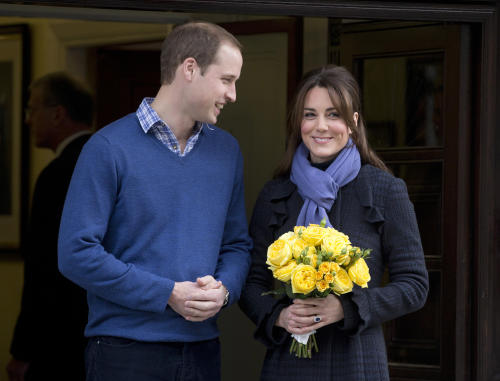 FILE - In this Thursday, Dec. 6, 2012 file photo Britain's Prince William stands next to his wife Kate, Duchess of Cambridge as she leaves the King Edward VII hospital in central London. Prince William's wife Kate has been admitted to the hospital in early stages of labor it was announced on Monday July 22, 2013. (AP Photo/Alastair Grant, File)