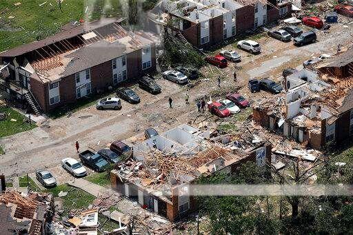 Flattened homes damaged in the tornado pictured.