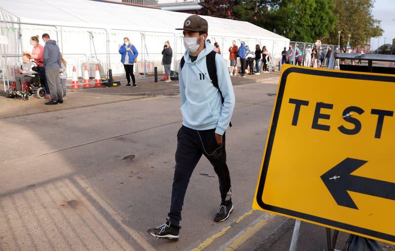 Britain's COVID testing buckles, pressuring government