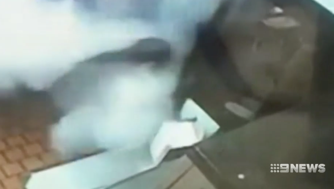 Heidelberg Heights McDonald's staff member is shown in CCTV being sprayed with a fire extinguisher. Source: 9News