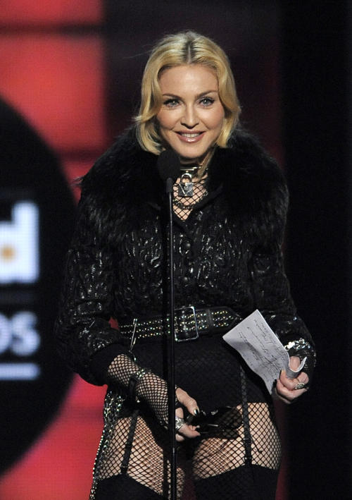 FILE - In this May 19, 2013 file photo, Madonna accepts the award for top touring artist at the Billboard Music Awards in Las Vegas. A minor tempest over an access road built on Madonna's Hamptons horse farm appears to have been settled. Newsday reports that Suffolk County officials sent Madonna a cease-and-desist letter. It said her 24-acre Bridgehampton property was improperly being used as a cut-through for construction vehicles to get to her adjacent land. (Photo by Chris Pizzello/Invision/AP, File)