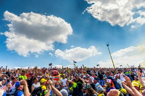 Marc Marquez climbed into the crowd to celebrate with fans after a ninth straight victory at the Sachsenring