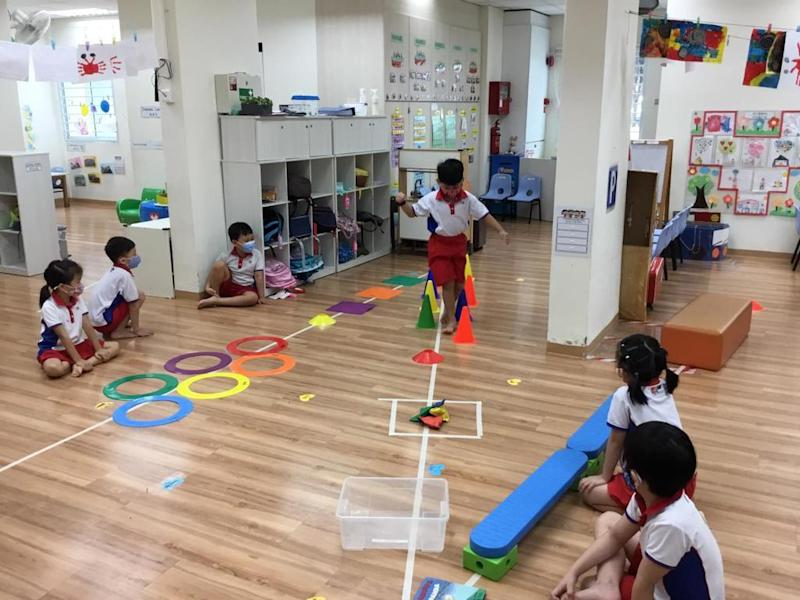 Pre-school kids at PCF Sparkletots Pre-school@Chua Chu Kang Block 19 negotiating obstacles in the grand finale of the Nurture Kids@GetActive! Singapore. (PHOTO: PCF Sparkletots)