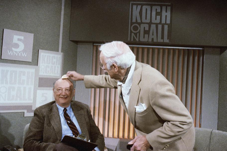 """FILE - In this March 15, 1987 file photo, New York Mayor Ed Koch gets his head powered by a make-up artist before the start of his new television call-in program, """"Koch on Call"""" at New York's Channel 5. Koch, the combative politician who rescued the city from near-financial ruin during three City Hall terms, has died at age 88. Spokesman George Arzt says Koch died Friday morning Feb. 1, 2013 of congestive heart failure. (AP Photo/David Bookstaver, File)"""