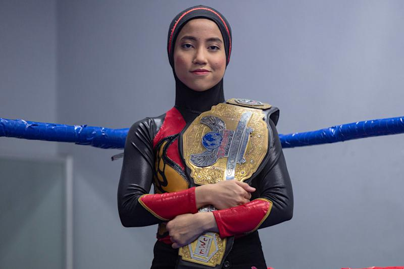 Nor 'Phoenix' Diana strikes a pose with her Wrestlecon Championship belt. — Picture by Mukhriz Hazim