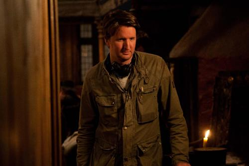 "This undated publicity photo released by Universal Pictures shows director, Tom Hooper, on the set of the film, ""Les Miserables."" (AP Photo/Universal Pictures, Kerry Brown)"