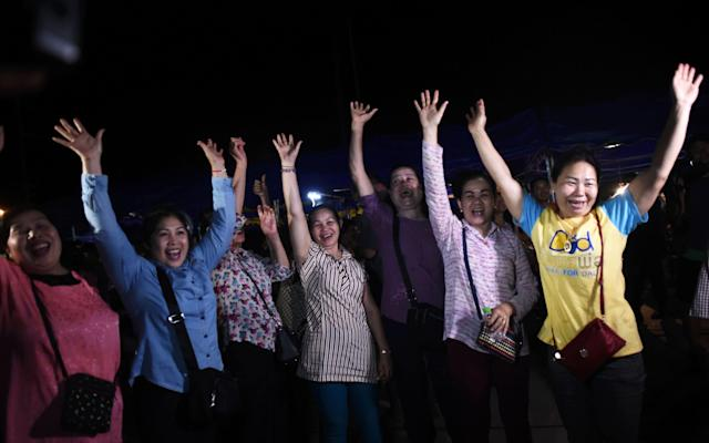 Volunteers celebrate at a makeshift press centre in Mae Sai district of Chiang Rai province - AFP