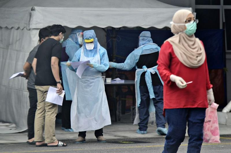 Government health workers attend to members of the public at the Kuala Lumpur Health Clinic March 24, 2020. — Picture by Shafwan Zaidon