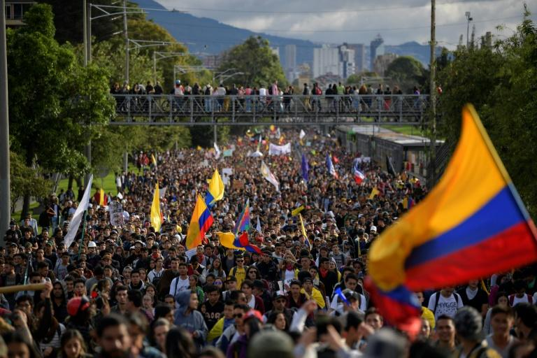 Tens of thousands march against the government of Colombian President Ivan Duque during a national strike in Bogota Wednesday
