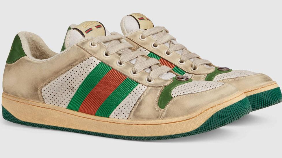<p>Designer brand Gucci is raising some eyebrows with their new Screener leather sneakers that are made to look 'distressed' and worn. Source: Gucci </p>