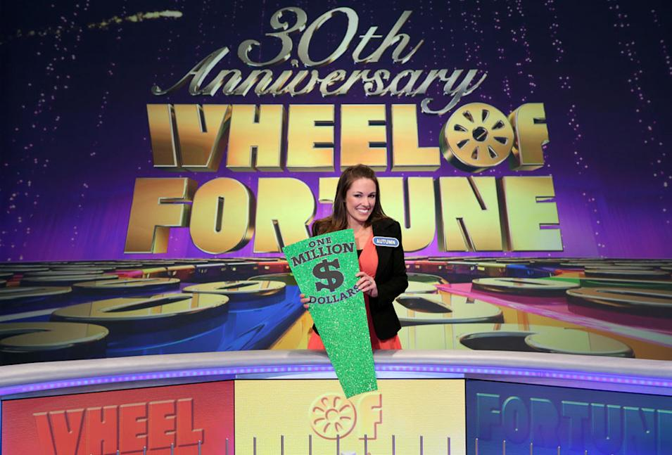 Million Dollar Grand Prize Winner Autumn Erhard poses at the Wheel with the Million Dollar Wedge