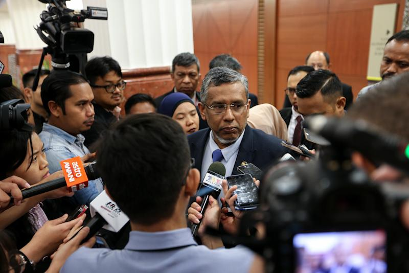 File photo of Deputy Minister Hanipa Maidin speaking to reporters at the Parliament lobby in Kuala Lumpur March 14, 2019. — Picture by Ahmad Zamzahuri