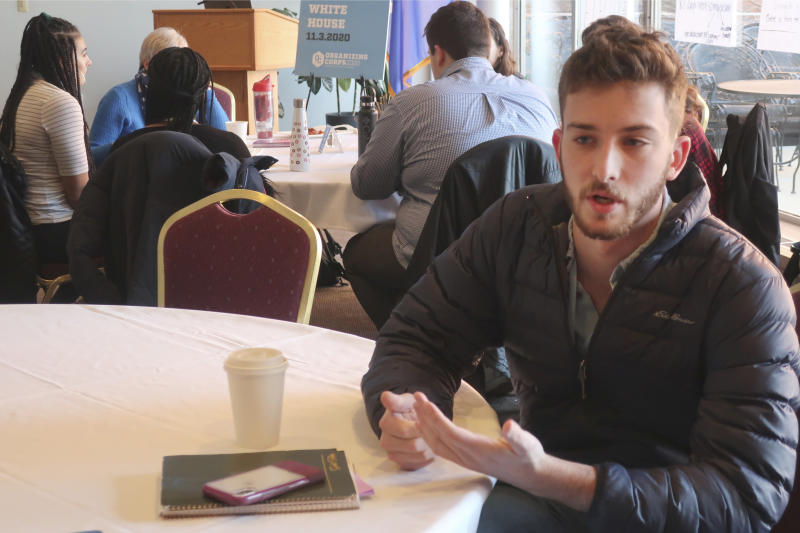 University of Wisconsin student David Pelikan, 21, talks about why organizing students like him to work for the eventual Democratic presidential nominee is crucial to defeating President Donald Trump in battleground states like Wisconsin, Thursday, Jan. 16, 2019, during a training session in Madison, Wis. (AP Photo/Scott Bauer)