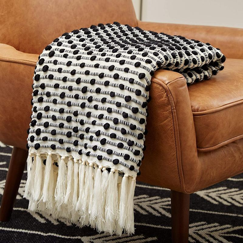 Rivet Bubble Textured Lightweight Decorative Fringe Throw Blanket. Image via Amazon.