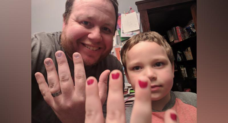 'Daddy blogger' Aaron Gouveia (left) and son Sam (right) wearing nail polish in a photograph posted on his Twitter account Daddy Files.