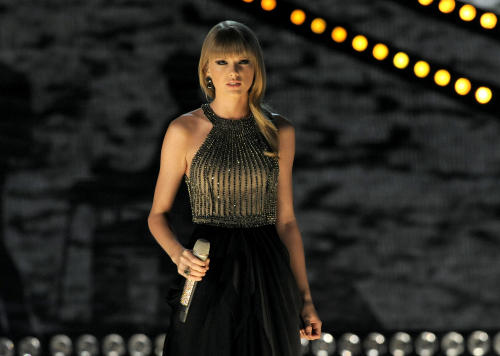 FILE - In this April 7, 2013 file photo, Taylor Swift performs at the 48th Annual Academy of Country Music Awards at the MGM Grand Garden Arena in Las Vegas. Swift, Hunter Hayes, Little Big Town, Luke Bryan and Pistol Annies are set to perform during this year's live show at the 2013 CMT Music Awards. (Photo by Chris Pizzello/Invision/AP, File)