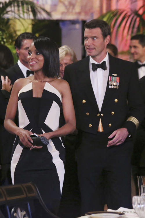 "FILE - In this image released by ABC actress Kerry Washington wears a Rubin Singer gown, left, with Scott Foley in a scene from ""Scandal."" In the realm where Hollywood meets fashion, Kerry Washington is royalty. On her hit show ""Scandal,"" playing professional fixer Olivia Pope, she was all professional Washington _ Washington, D.C., that it _ but on the red carpet, she was glamour personified. (AP Photo/ABC, Richard Cartwright)"