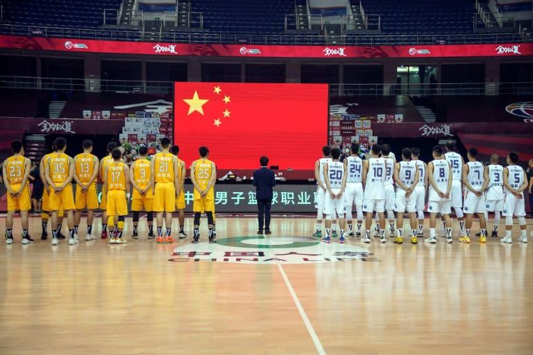 Players from Nanjing Monkey Kings and Zhejiang Guangsha Lions paid tribute to those who died of coronavirus